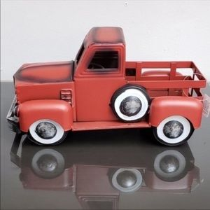 Collectible rustic red pick-up truck.